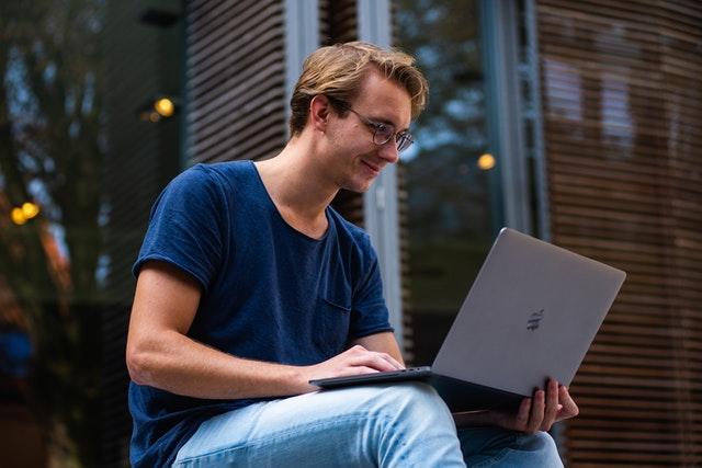 selective focus photo of man using laptop 1438081